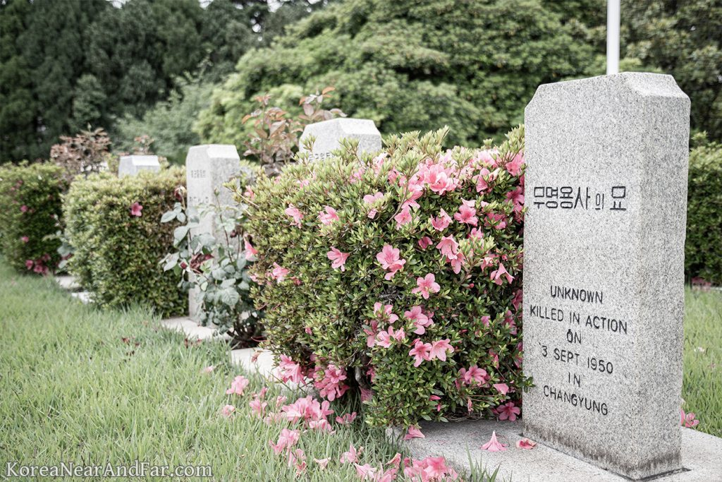 tombstone of unknown soldier at UN Memorial Cemetery in Busan South Korea
